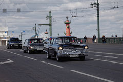 SAINT-PETERSBURG, RUSSIA - 21 MAY 2017: Parade of vintage cars. Old automobiles. Tinted photo. Stock Photo