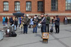 Street musicians playing wind instruments in Saint Petersburg Royalty Free Stock Photo