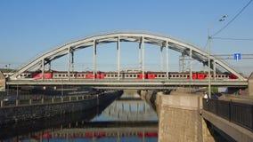 Suburban train passes over the American bridge. Saint Petersburg. SAINT PETERSBURG, RUSSIA - MAY 17, 2018: Suburban train passes over the American bridge stock footage