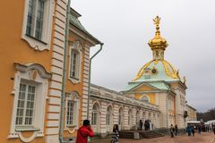 Tourists visit The Peterhof Palace garden, St. Petersburg. Royalty Free Stock Photo