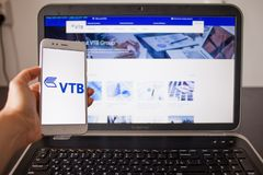 SAINT PETERSBURG, RUSSIA - MAY 14, 2019: Website and logo of the Russian bank VTB on the screens of gadgets stock photo