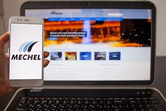 SAINT PETERSBURG, RUSSIA - MAY 14, 2019: Website and logo of the Russian company Mechel on the screens of gadgets royalty free stock photo