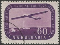 Saint Petersburg, Russia - November 27, 2018: Postage stamp printed in Bulgaria with the image of the glider, circa 1956 stock images