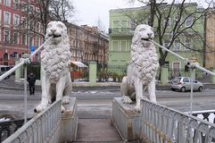 Statues of lions on the Lion bridge in Saint Petersburg. SAINT PETERSBURG, RUSSIA - NOVEMBER 14, 2009: Statues of lions on the Lion bridge stock photography
