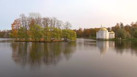 October evening on the big pond. The view of the Turkish bath pavilion. Catherine Park of Tsarskoye Selo. SAINT PETERSBURG, RUSSIA - OCTOBER 17, 2017: October stock footage