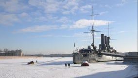 Saint-Petersburg. Russia. People near Cruiser Aurora stock footage
