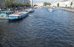 Saint Petersburg, Russia September 10, 2016: Excursion ships in the river of Fontanka. The view from Anichkov bridge in St. Peters. Excursion ships in the river royalty free stock photography
