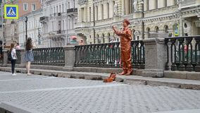 Saint-Petersburg. Russia. Street actress on Griboyedov Channel stock footage