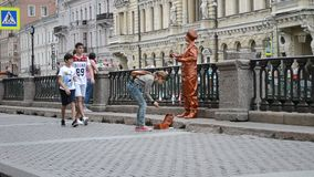 Saint-Petersburg. Russia. Street actress near Griboyedov Channel stock footage