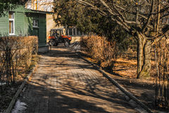 Saint Petersburg, Russia, 03/15/2017 - Tractor mini working in botanical garden. Saint Petersburg, Russia, 03/15/2017 - Tractor working  in  botanical garden Stock Image