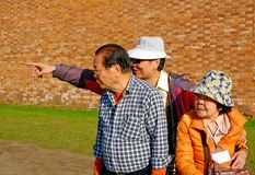 Tourists from Japan near the walls of the Peter and Paul fortress stock image