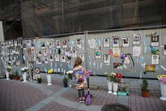 Saint Petersburg Russia a young tourist looks at a spontaneous memorial to doctors who died of covid 19