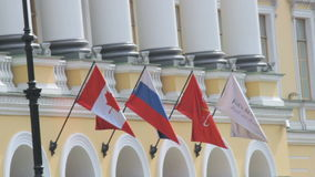 Saint Petersburg, Russian Federation - July 1, 2016: Russian and Canadian flag flutters in the wind on a building, close. Up Full HD stock video footage