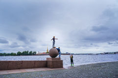 Saint-Petersburg. Summer 2016. Young people having fun taking pictures on the ball spit of Neva river. Royalty Free Stock Images