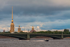 Saint-Petersburg view with bridge water and spire. Cloudy morning shot Royalty Free Stock Photo