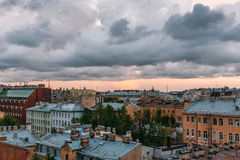 Saint Petersburg view from roof top. St. Petersburg cityscape, dramatic clouds, old buildings, famous tourist place Royalty Free Stock Photography