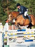 SAINT PETERSBURGO 5 DE JULHO: Rider Aleksandr Belekhov no chacal Ugl Imagem de Stock Royalty Free