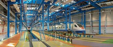 SAINT-PETRSBURG, RUSSIA, JUL, 08, 2010: Panoramic vew on high speed trains Pendolino ALLEGRO at maintenance MOT in depot. SAINT-PETRSBURG, RUSSIA, JUL, 08, 2010 royalty free stock photos