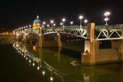 Saint-Pierre Bridge Toulouse, France. Saint-Pierre Bridge and Hopital de la Grave at night. Toulouse, France royalty free stock images
