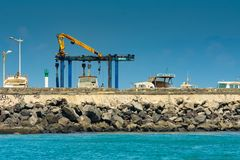 Saint-Pierre, France - September 27 2018: Sunny blue sky profile of harbor in Saint-Pierre Reunion Island.  royalty free stock image