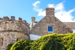Landscapes and architectures of Brittany. Saint Pierre Quiberon, France , ancient houses and tower in the village Stock Photo