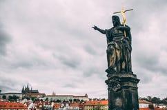 Saint on prague charles bridge. With golden cross Stock Image