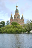 Saint Pyotr and Pavel's cathedral on the bank of Holguin of a pond in Peterhof Stock Images