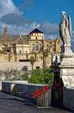 Saint Raphael on the Roman bridge and Cathedral in Cordoba Royalty Free Stock Image