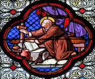 Saint Remi. Miracle of the oil filled pitcher. Stained glass window in the Basilica of Saint Clotilde in Paris, France stock photo
