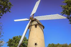 Architecture detail of the windmill still active. Saint Reverend, France - July 24, 2016 : architecture detail of the windmill still active on a summer day Royalty Free Stock Photos