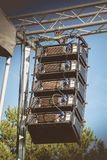 DVB-T4 speaker cluster from manufacturer DBTechnologies on a pub Royalty Free Stock Photos