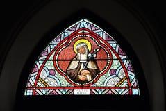 Saint Rose de couleur en verre souillé Photo libre de droits
