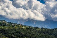 Saint-Sauveur village on mountain hill Stock Photography