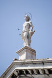 Saint Sebastian statue, Venice. Statue of the Christian martyr Saint Sebastian.  Shot with arrows, on top of the Chiesa di San Sebastiano, Venice, Italy Stock Photo