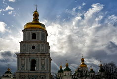 Saint Sophia bell tower with cloudy sky on the background. Sunny and windy spring day backdrop. Orthodox Kiev. Easter 2017 Stock Images