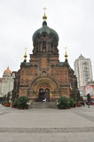 Saint Sophia Cathedral Harbin China. Chinese tourists around Saint Sophia Cathedral in Harbin Heilongjiang province China on an overcast gray sky day stock photos
