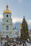 Saint Sophia Cathedral in Kiev, Ukraine. Christmas time. People visit Christmas fair in front of Saint Sophia Cathedral bell tower. Saint Sophia Cathedral is an Stock Photos