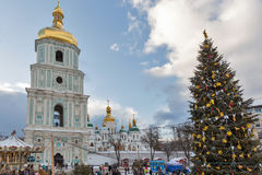 Saint Sophia Cathedral in Kiev, Ukraine. Christmas time. People visit Christmas fair in front of Saint Sophia Cathedral bell tower. Saint Sophia Cathedral is an Royalty Free Stock Photography