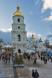 Saint Sophia Cathedral in Kiev, Ukraine. Christmas time. People visit Christmas fair in front of Saint Sophia Cathedral bell tower. Saint Sophia Cathedral is an Royalty Free Stock Image