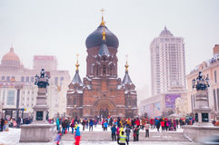 Saint Sophia Cathedral and People. This is the Saint Sophia Cathedral which in Harbin City of China. It's a famous tourist attraction and many people like to go royalty free stock photo