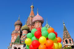Saint Basil`s Cathedral in Moscow on Red Square. Saint St Basil`s Cathedral in Moscow on Red Square against a blue sky and with a bunch of colorful balloons in Stock Image