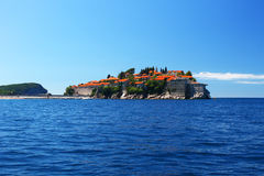 Saint Stephen island Montenegro from sea. View from the sea over the old buildings of the Sveti Stefan - Saint Stephen small island from Montenegro stock images