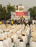Saint Tarunsagar addressing 1000 Gandhi dressed students. Abhay Ghat, Sabarmati Ashram, Ahmedabad, India on 2nd October, 2012 - School children sitting and Stock Photos