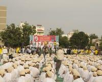 Saint Tarunsagar sitting on stage and addressing 1000 Gandhi dre. Abhay Ghat, Sabarmati Ashram, Ahmedabad, India on 2nd October, 2012 - School children sitting Royalty Free Stock Image