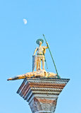 Saint Theodore at the San Marco, Venice, with the moon in the background Royalty Free Stock Photo