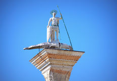 Saint Theodore statue Venice Italy. Granite column top carrying one of symbols of the two patron saints of Venice at Piazzetta di San Marco.Saint Theodore, who Royalty Free Stock Image