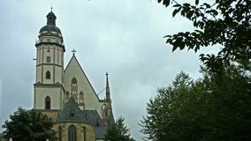 Saint Thomas church in Leipzig, Germany. Extreme wide angle shot of St. Thomas church in Leipzig, Germany, home of the famous cantor and composer Johann stock video footage