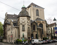 Saint Trinity Church in Brussels, Belgium. View of Saint Trinity Church, a catholic monument in Brussels, Belgium. A small statue in the center of the picture Royalty Free Stock Image
