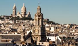 The Saint Trinity church and Sacre Coeur basilica, Paris, France Royalty Free Stock Images