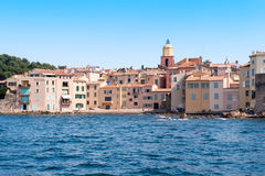 Saint Tropez. The church, colored houses blue water and blue sky in Saint Tropez stock images